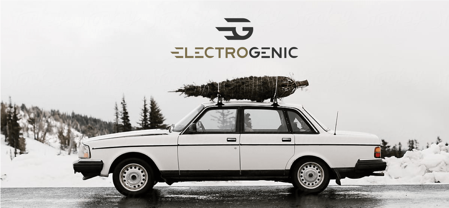 white Volvo with Christmas tree on roof